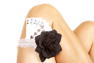 woman legs cards in garter royal flush knees
