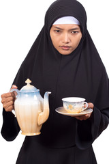 woman carries tea service