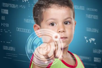little boy pressing high tech type of modern buttons on a virtua