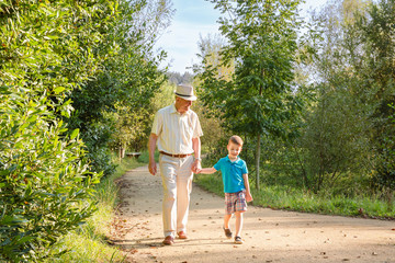 Grandfather and grandchild walking outdoors