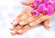 french manicure with orchids