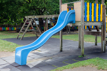 Blue toboggan in the middle of a playground