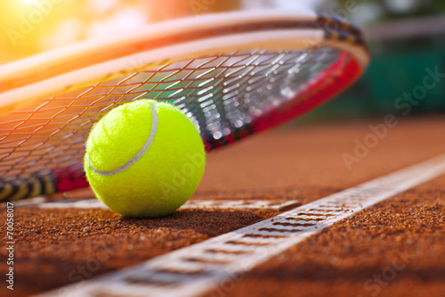 Poster .tennis ball on a tennis court