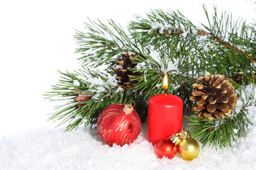 Christmas composition with burning candle and decorations