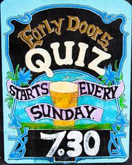 Close up on colorful British pub quiz sign