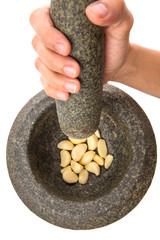Stone Mortar And Pestle With Garlic