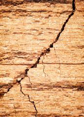 Broken brick wall with crack