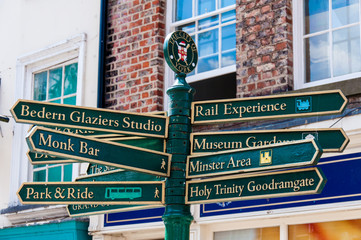 Closeup on tourist Sign posts in historical city of York, UK