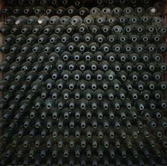 Rows of many empty wine bottles