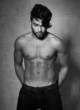 sexy fashion man model top naked posing dramatic on grunge wall