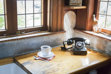 Antique Phone and Cup of Coffee in Old Kitchen Setting