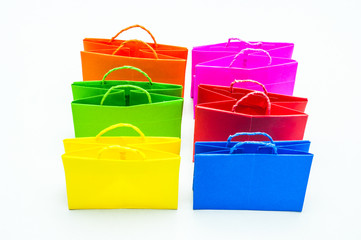 Colourful paper shopping bags isolated on white.