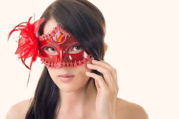 woman in a carnival mask