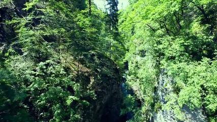 flying through vintgar gorge in the slovenian alps