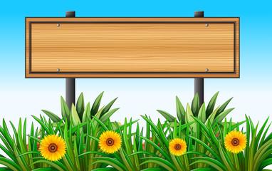 An empty wooden signboard at the garden