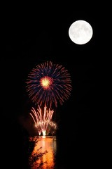 Fireworks over  river & Moon