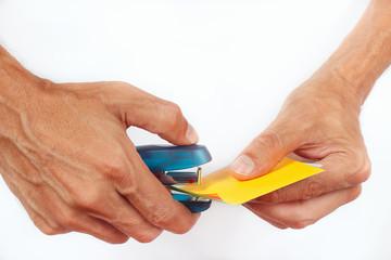 Hands bonded paper stapler on a white background