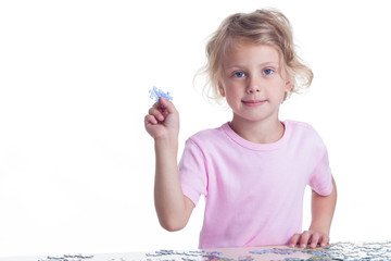 Girl playing puzzles