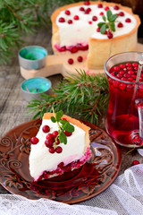 piece of white cheesecake with cranberries