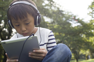 Boy to the tablet game