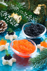 Christmas appetizers - red and black caviar, vertical