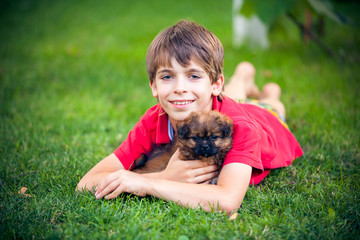 Young Boy Hugging his Dog