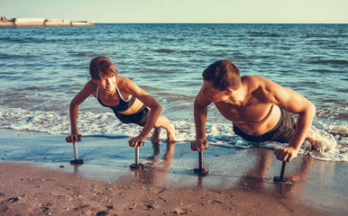 sport and lifestyle concept - family doing sports outdoors