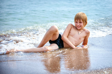 boy on a beach in sand