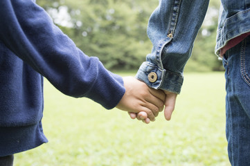 Holding Hands siblings in the park