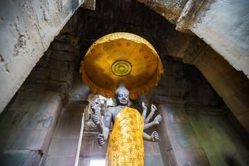 a statue of the Hindu god Vishnu at.Angkor Wat, Cambodia.
