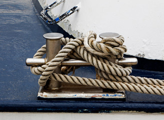 Bollard on the ship and tied rope