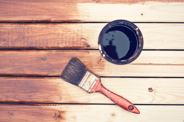 painting wooden table using paintbrush