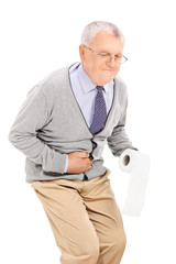 Senior with stomach ache holding toilet paper