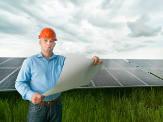 engineer holding solar panel station plan