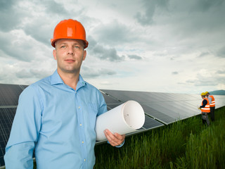 engineer standing in front of solar panels
