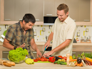 two men having fun in kitchen