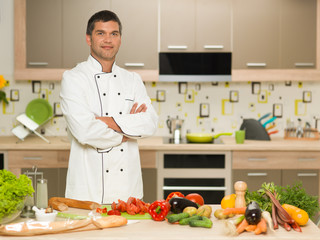 confident chef standing in kitchen