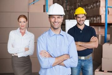 Warehouse team smiling at camera