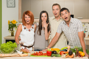 friends acting surprised while cooking