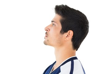 Side view of football player looking up