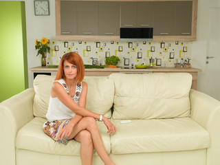 woman sitting on a couch, relaxed
