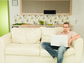 man reading something on laptop