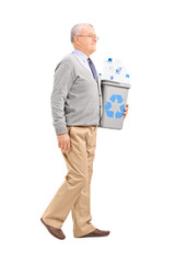 Senior man holding a recycle bin
