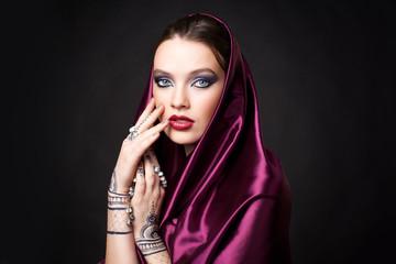 beautiful woman in oriental style with mehendi