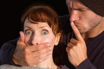 Man grabbing woman around mouth