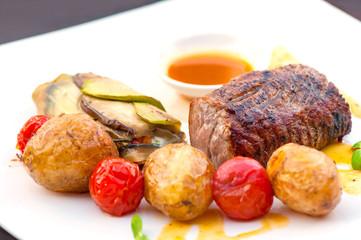 Prime grilled juicy beef steak with roasted vegetables