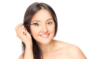Beautiful woman putting on make-up