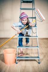 happy little girl on a folding ladder