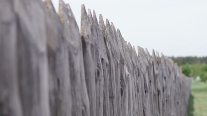 wooden fence in the village of the whole vertical timber