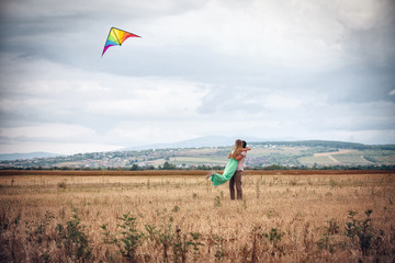 happy young couple flying a kite